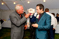 Actor Graham Cole OBE with ventriloquist Steve Hewlett at a charity event